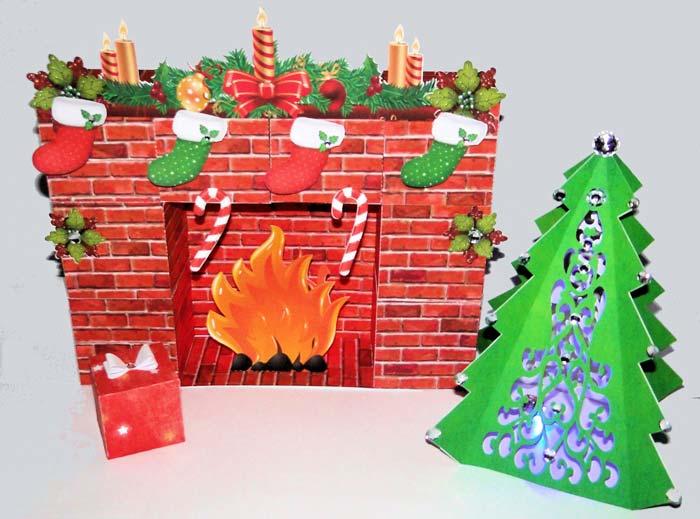 Камин из картона можно дополнить свечами или нарисованным очагом